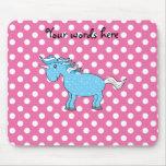 Blue unicorn on pink polkadots mouse pad