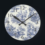 """Blue Vintage Toile Round Clock<br><div class=""""desc"""">Blue vintage toile on unique gifts such as throw pillows,  mouse pads,  kitchen towels,  garden/kitchen tiles,  I phone cases,  and more.</div>"""