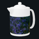 "Blue Violet Garden Teapot<br><div class=""desc"">A garden of blues and purples on this teapot will be sure to brighten your day. Add the mug and give the set as a gift.</div>"