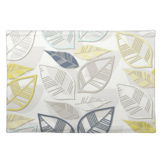 blue yellow gray leaves in rows on white place mats