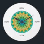 "Blue, Yellow, &amp; Green Mandala &quot;Now&quot; Large Clock<br><div class=""desc"">Is it time to refresh your home? There&#39;s no time like the present. This round wall clock features an intricately-detailed blue, yellow, and green mandala created by Janusian Gallery artists for Just_Mandalas. Keep track of your meditation practice. Also makes a thoughtful housewarming gift. And because this kaleidoscopic image is based...</div>"