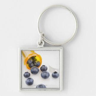 Blueberries spilling from prescription bottle keychain