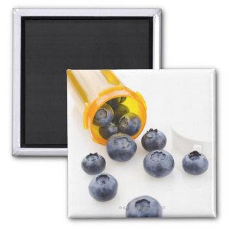 Blueberries spilling from prescription bottle magnet