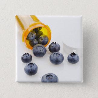 Blueberries spilling from prescription bottle pinback button