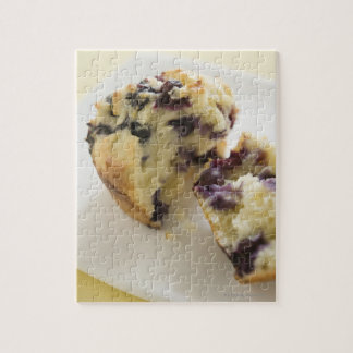 Blueberry muffin split open on a white plate puzzle