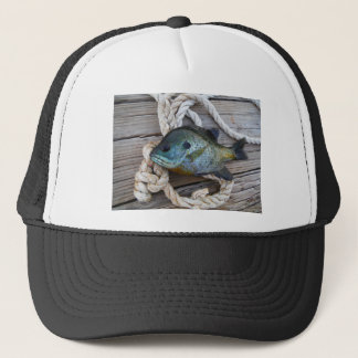 Bluegill fish on dock and rope trucker hat