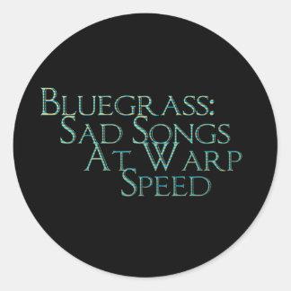Bluegrass: Canciones tristes a la velocidad de la Pegatina Redonda