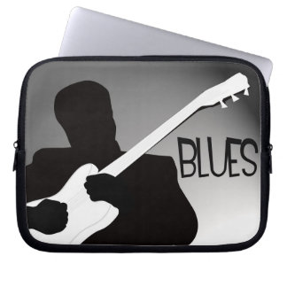 Blues player's silhouette with a spotlight b&w laptop sleeves