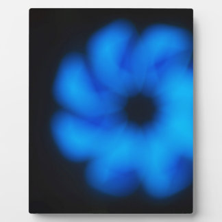 Blurred and out of focus image of an abstract blue plaque