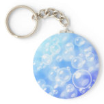 Blurred bubbles over blue keychain
