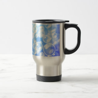 Blurred bubbles over blue coffee mug