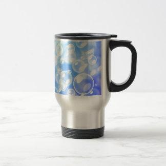 Blurred bubbles over blue travel mug