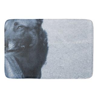 blurred dog looking left blue half bath mat