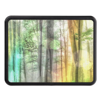 Blurred forest tow hitch cover