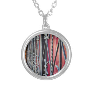 Blurred fragment of an ancient building silver plated necklace