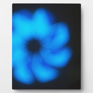 Blurred image of an abstract blue shapes closeup plaque