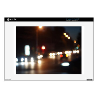 Blurred out of focus lights from cars in a night laptop skins