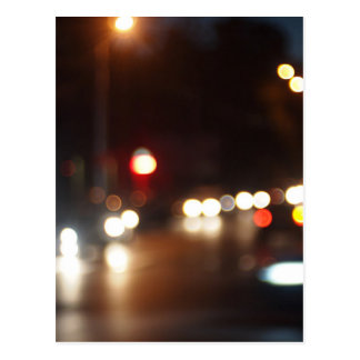 Blurred out of focus lights from cars in a night postcard