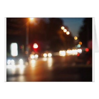 Blurred out of focus lights from cars in a night s card