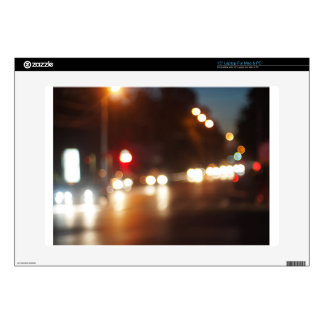 Blurred out of focus lights from cars in a night s laptop skin