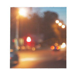 Blurred out of focus lights from cars in a night s notepad
