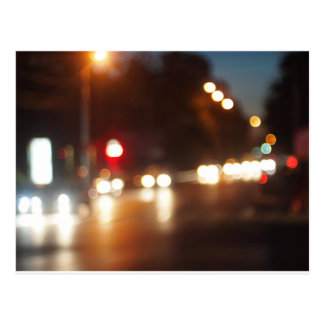 Blurred out of focus lights from cars in a night s postcard