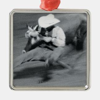 Blurred shot of cowboy wrestling steer metal ornament