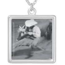 Blurred shot of cowboy wrestling steer silver plated necklace
