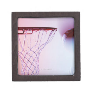 Blurred view of basketball going into hoop jewelry box
