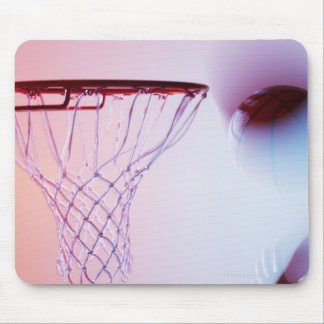 Blurred view of basketball going into hoop mouse pad