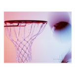 Blurred view of basketball going into hoop postcard