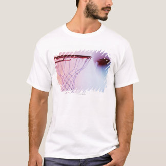 Blurred view of basketball going into hoop T-Shirt