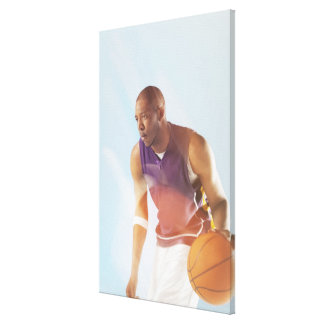 Blurred view of basketball player dribbling 2 canvas print