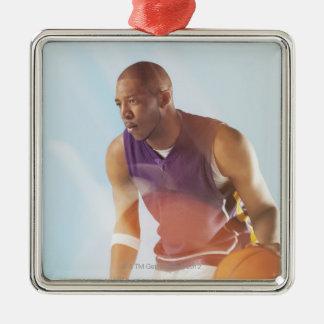 Blurred view of basketball player dribbling 2 metal ornament