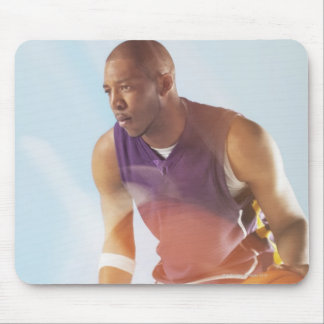Blurred view of basketball player dribbling 2 mouse pad
