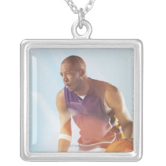Blurred view of basketball player dribbling 2 square pendant necklace