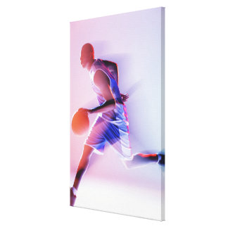 Blurred view of basketball player dribbling canvas print