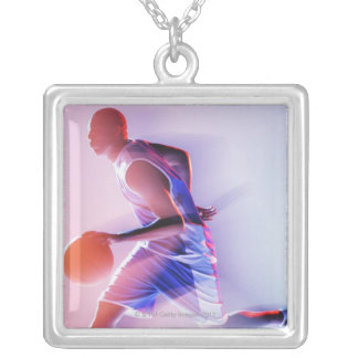 Blurred view of basketball player dribbling square pendant necklace