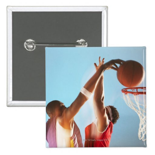 Blurred view of basketball player dunking button