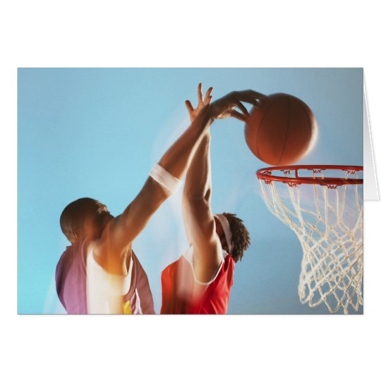 Blurred view of basketball player dunking card