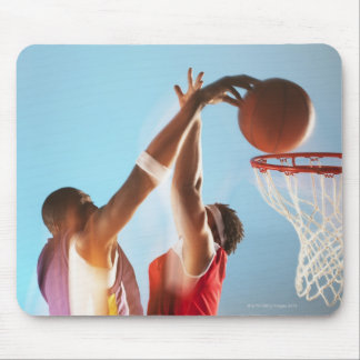 Blurred view of basketball player dunking mouse pad