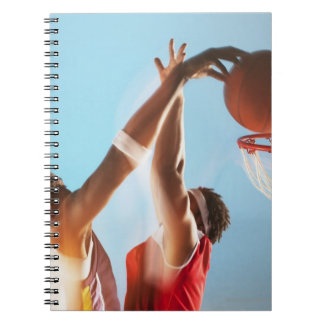 Blurred view of basketball player dunking spiral note book