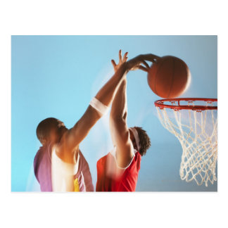 Blurred view of basketball player dunking postcard
