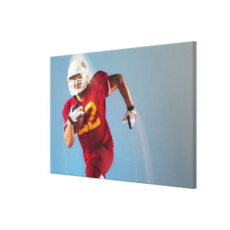 Blurred view of football player running with canvas prints