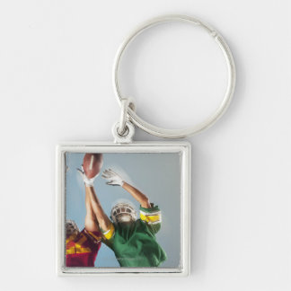 Blurred view of football players reaching for keychain