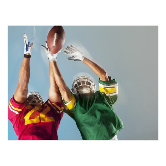 Blurred view of football players reaching for postcard