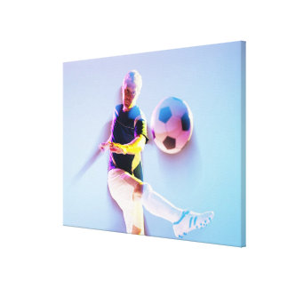 Blurred view of soccer player kicking ball 2 canvas print
