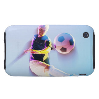 Blurred view of soccer player kicking ball 2 iPhone 3 tough covers