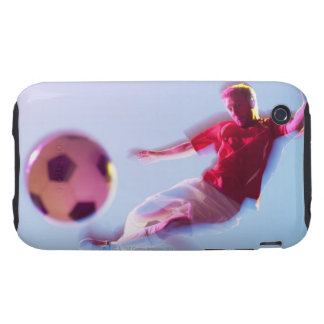 Blurred view of soccer player kicking ball tough iPhone 3 cover