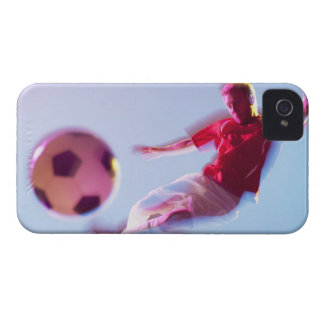 Blurred view of soccer player kicking ball iPhone 4 case